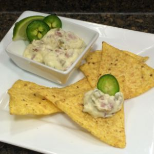 Image of Queso Blanco Slow Cooker Dip featuring Johnsonville® Jalapeno and Cheese Smoked Sausage