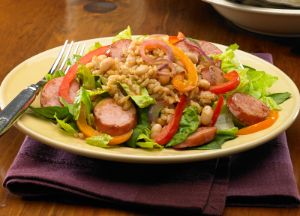 Image of Smoked Sausage and Brown Rice Garden Salad w/ Tomato Balsamic Dressing